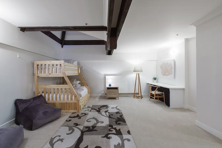 The fifth level acts as a kids sanctuary with two large bedrooms, a grand bathroom and private bunk beds