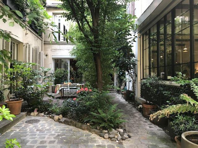 Une spacieuse maison loft à Bastille avec jardin