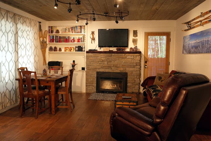 The main room of the house, showcasing cozy rustic touches.