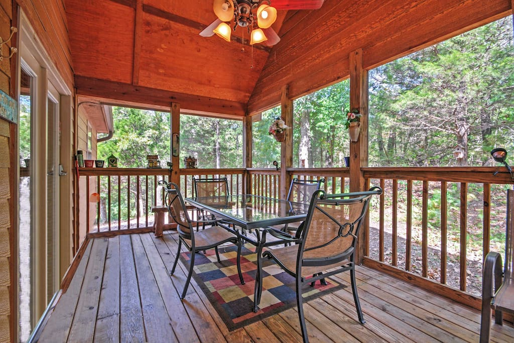 Take in the scenery while playing a board game on the screened-in porch.