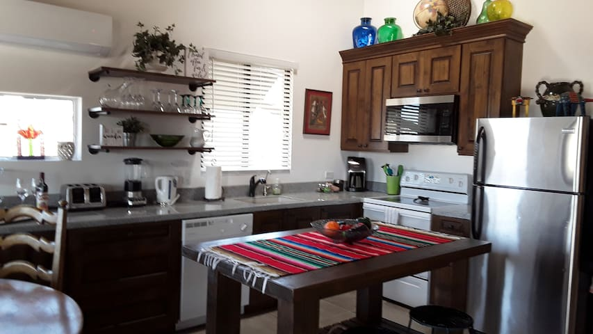 Fully stocked kitchen with microwave, range, dishwasher, full size fridge and all appliances
