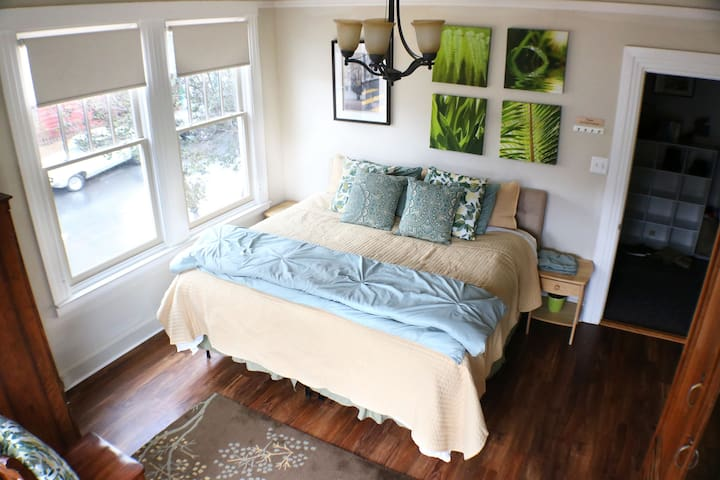 Twin Peaks Room #2; Large Corner Bedroom with King Bed; Bay Windows on one side and double windows with street view on other