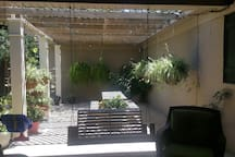 Beautiful patio for you to relax and enjoy. Waterfall and beautiful plants. Patio has sofa and cushioned chairs for you to enjoy.
