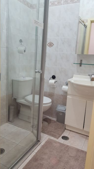 Two bathrooms. One with a shower and toilet and the other with a toilet plus a washing machine and clothes dryer