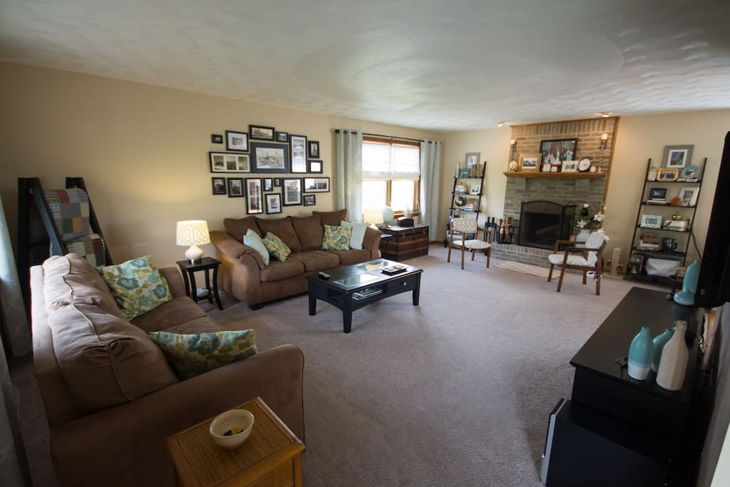 Large open living room with 2 full size couches