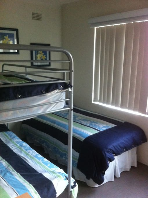 Second BR sleeps 3, a single bed and double bunk, built in robe, ceiling fan, portacot for babies.