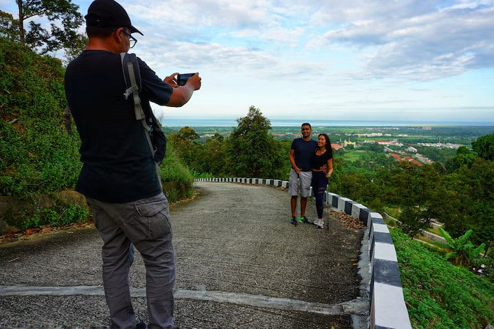 taking picture at hill top