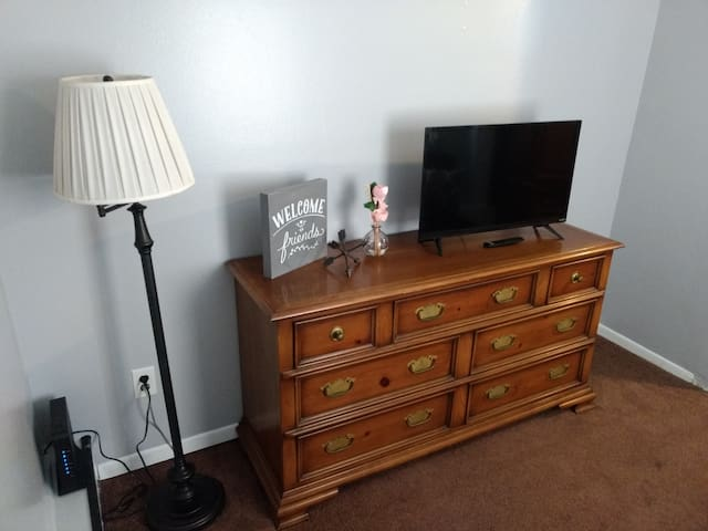 Use this dresser for your extra stuff, or just enjoy the smart TV with high speed internet. Log in to your own Netflix or watch ours.