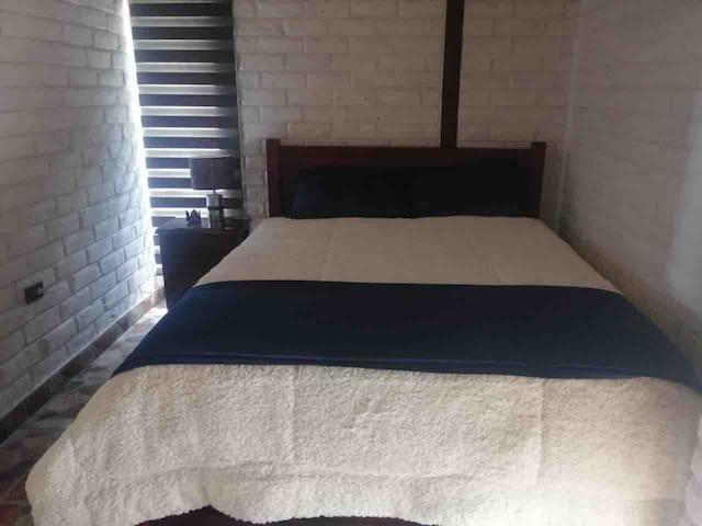 cama Queen y habitacion principal