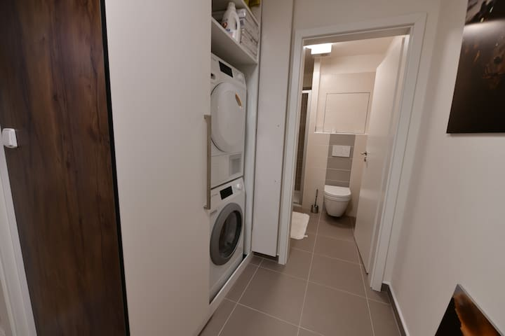 There is plenty of storage in the entrance hall as well as a washer and dryer.