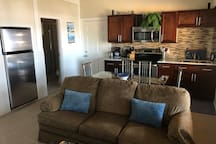 Open concept kitchen and living room with wall to wall ocean-view windows! There is also a TV with cable and guest Netflix account.