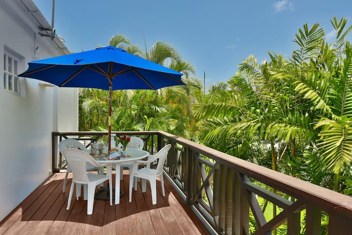 "Villa ""B"" features a large wooden deck with dining area which is accessed through the kitchen. The deck is surrounded by lush mango trees and a great place to observe monkeys frolicking in the trees."