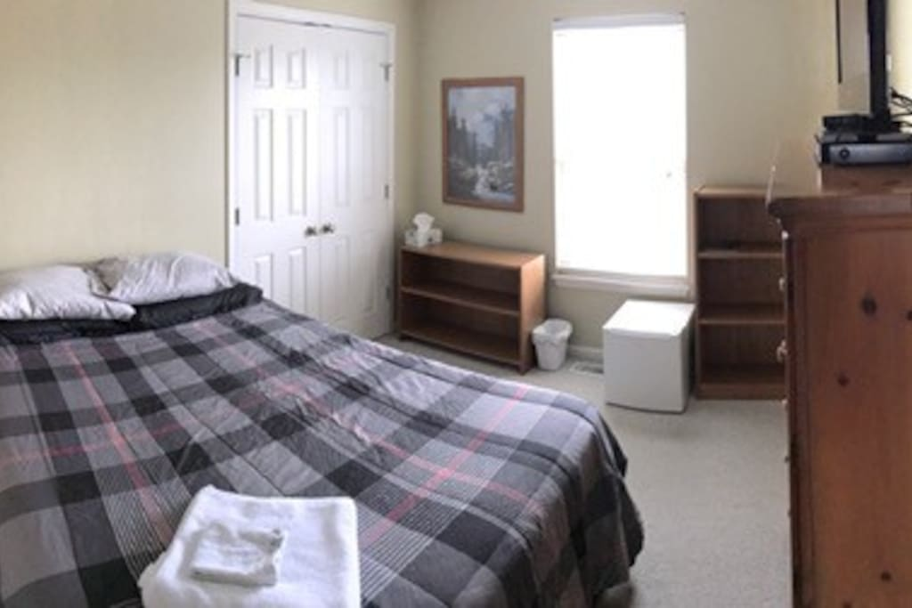 Great room with many amenities. Beautiful room setup with, refrigerator, closet storage, trashcan, comfortable Queen size Serta bed, flat screen television, Direct TV, and more.