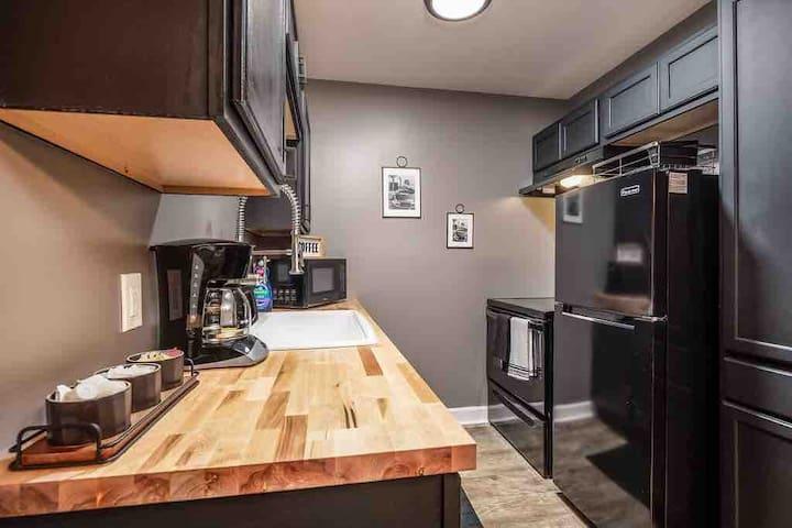 Kitchen with butcher block countertops.