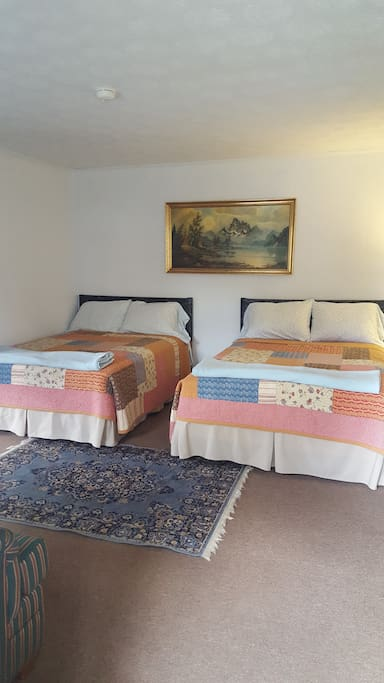 20 x 20 Bedroom with two comfortable full size beds, relax after a day of sun & sand.