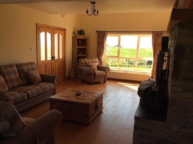 Living room with beautiful unspoilt views of Tramore and Sheephaven Bay