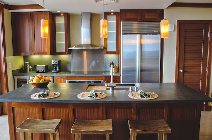 The kitchen features designer appliances to bring out the iron chef in you!