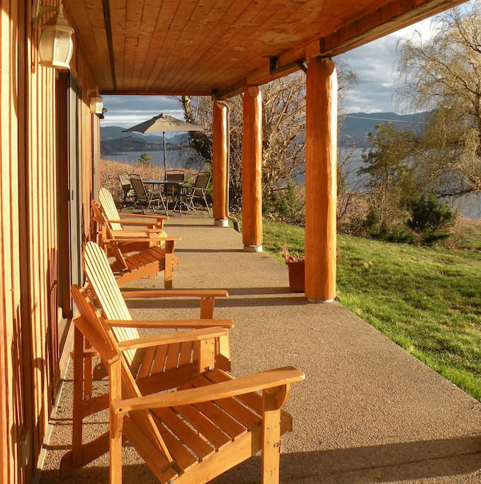 your private deck, stunning sunset, lake, and vineyard view!