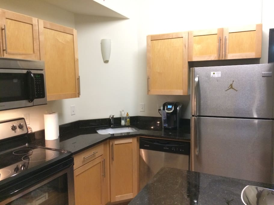 Kitchen with appliances and keurig coffees machine