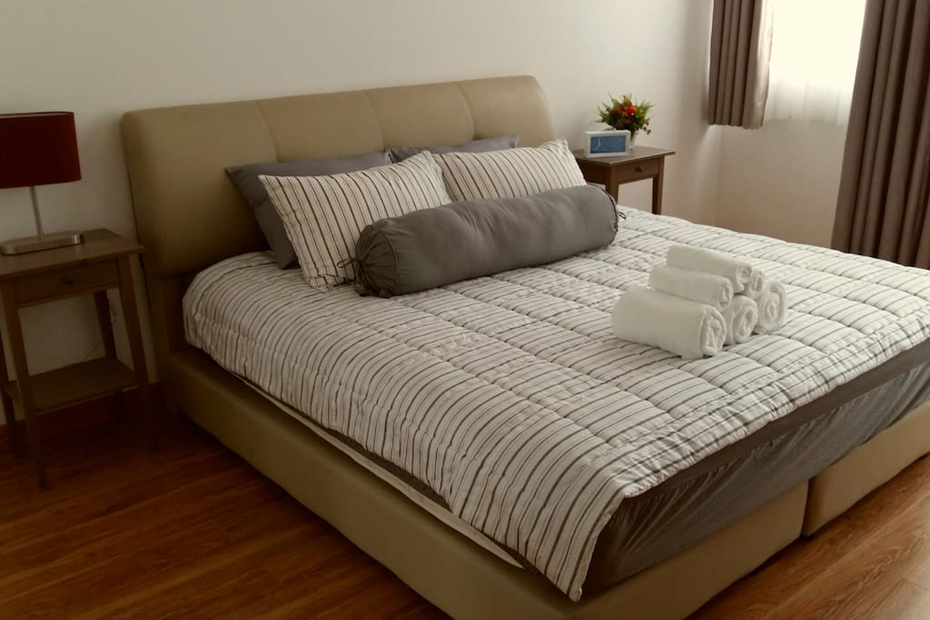 A King size bed in the Master Bedroom with en-suite bathroom