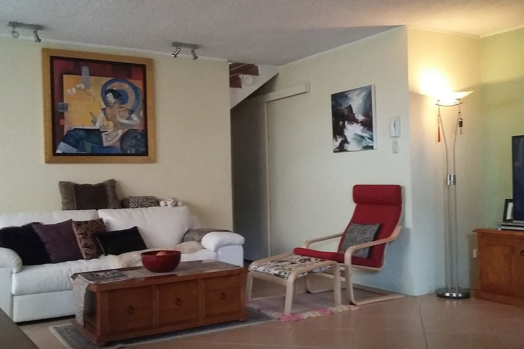 """Comfy lounge room, 55"""" TV and DVDs"""