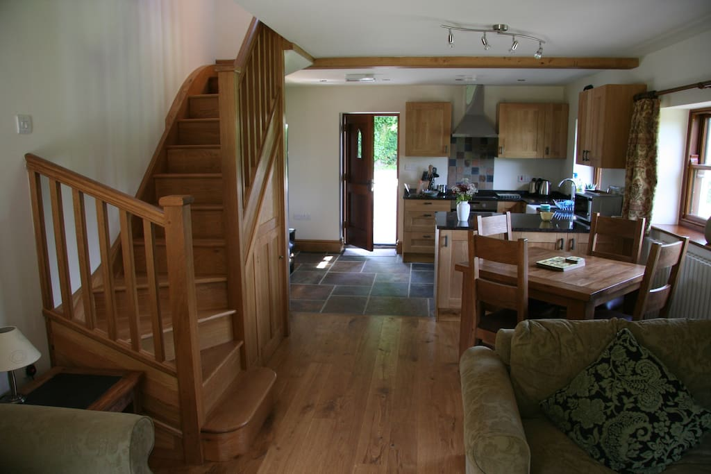 Spacious open plan lounge/diner with handmade oak staircase.