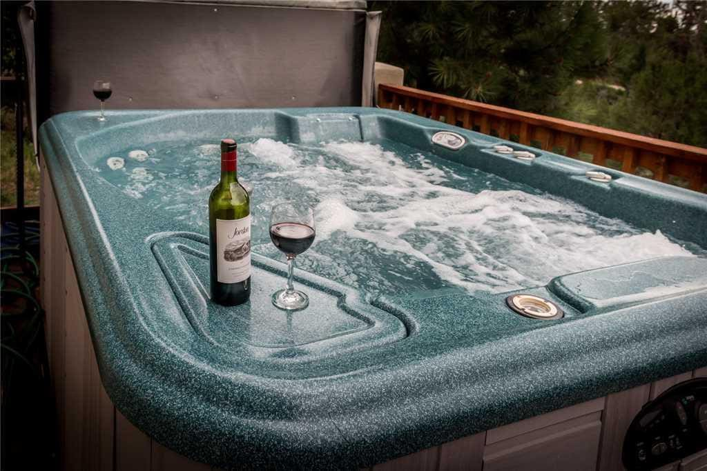 Upper Hot Tub Living - A relaxing soak in the hot tub after a day of shopping is the perfect end to a long day.Deck Hot Tub