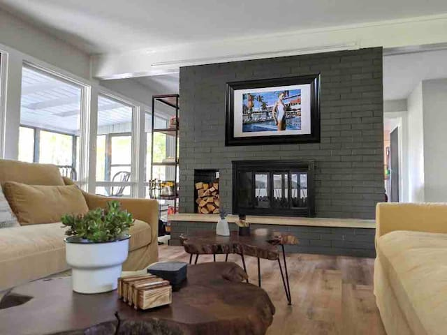 Living Room Fireplace. Double-sided to be enjoyed in multiple rooms.