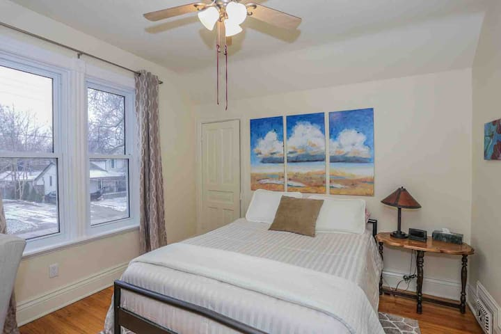 Spacious queen bed in room, with ample his & hers closets.