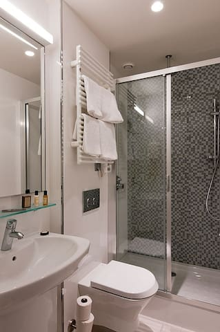 Our private bathroom is equipped with a large shower
