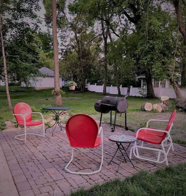 Patio with charcoal and portable gas grill.