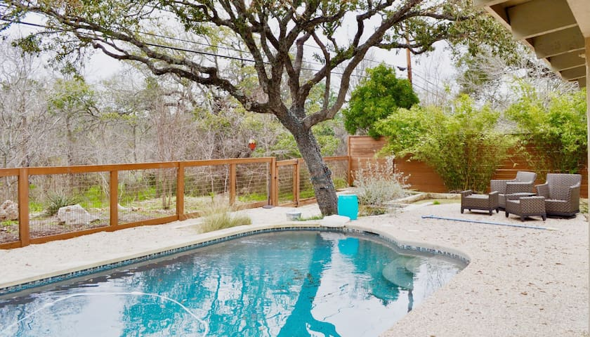 Fenced pool area complete with entertaining area. Privacy fences and the back of the property backs to a greenbelt. Yard games available.