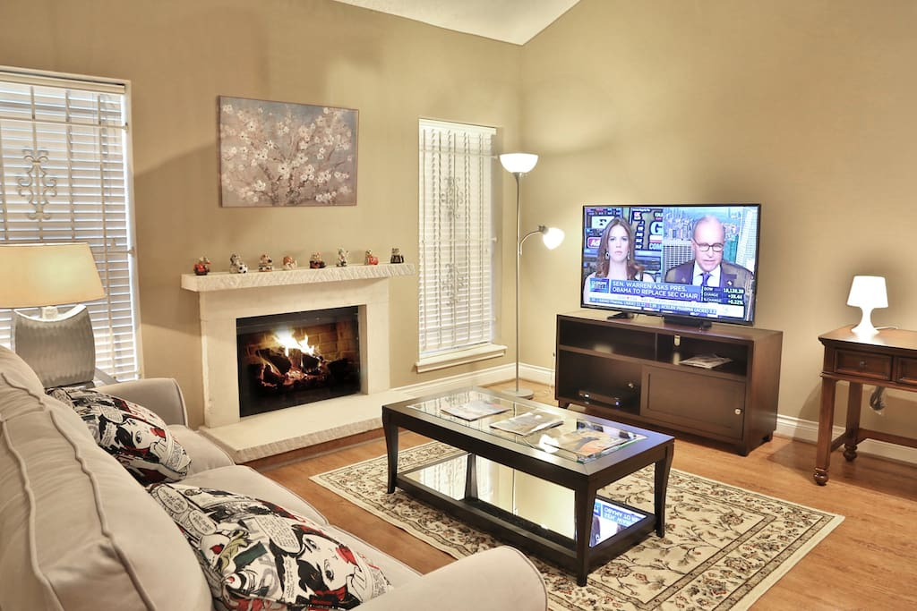 Living room with TV and fireplace.