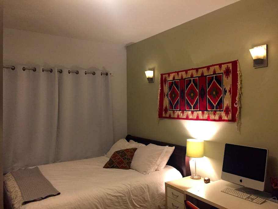 Queen-sized bedroom at the front of the apartment