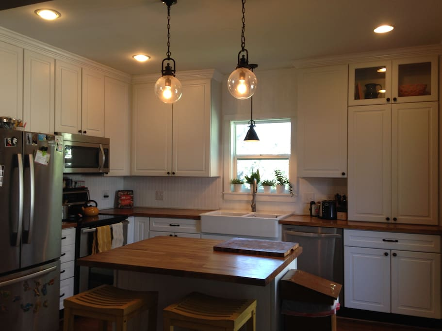A recently renovated kitchen that is ready for a delicious meal.