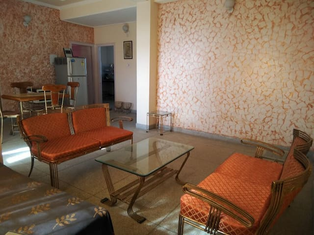 Sitting room  Cosy comfortable, with a comfortable diwan to accomodate one person