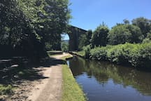 The canal in Uppermill is perfect for a gentle stroll, or lunch at one of the canal-side cafes