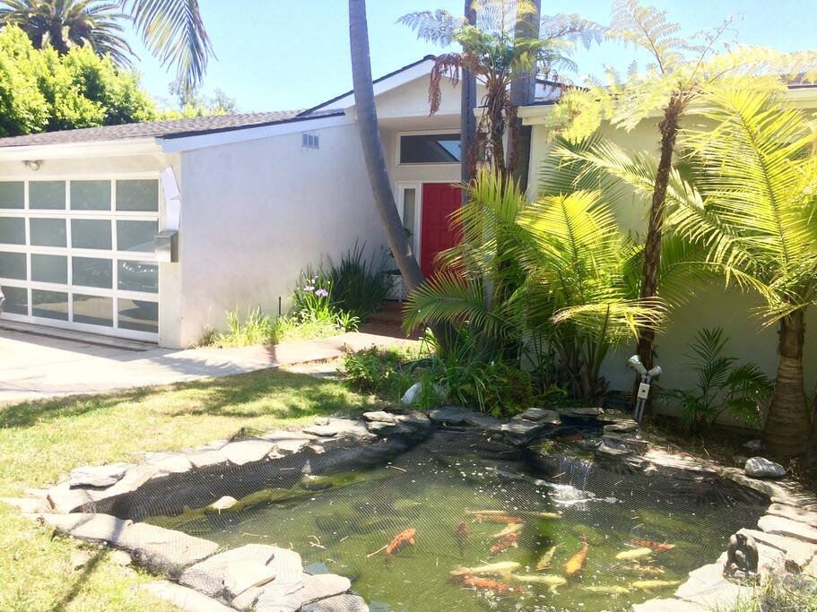 You'll love the sound of the fountain and koi pond in the front yard!