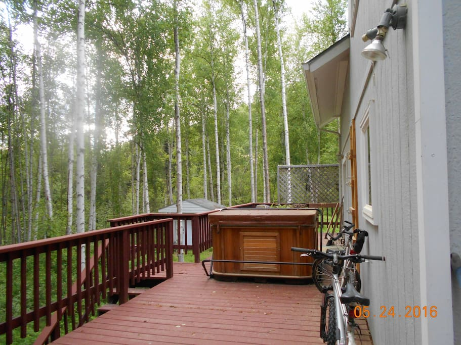 Back deck with hot tub in the birch trees