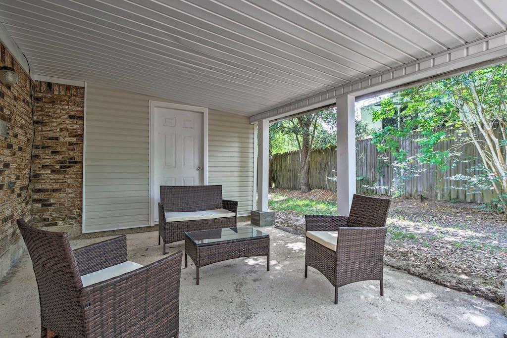 After a day on the coast, retreat to the shaded patio with outdoor furniture.