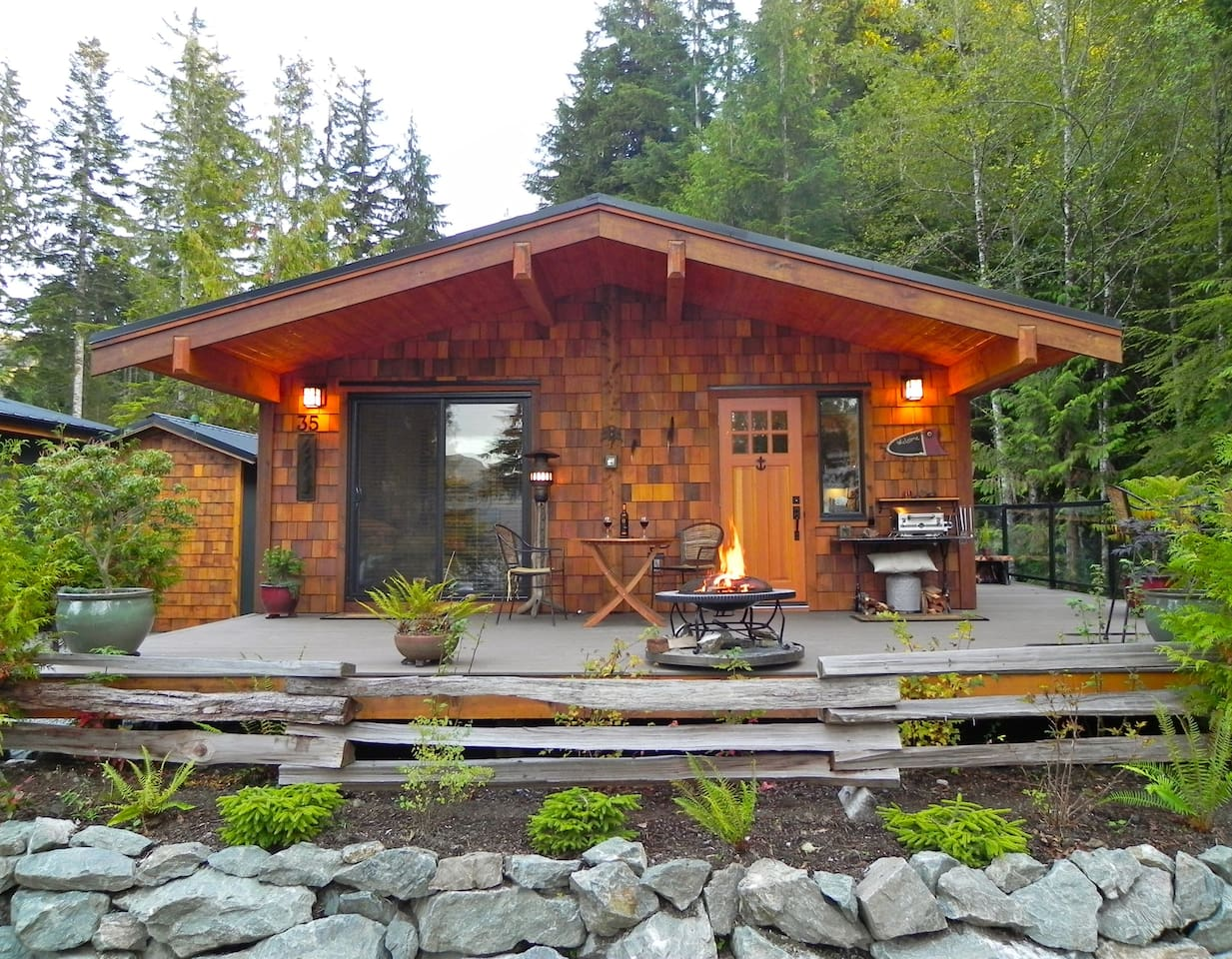 West Coast style cottage with large open deck , BBQ and firepit , immediate access to viewing platform .