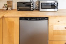 Mini fridge, micorwave, toaster oven and nearby dishwasher and stove top ready for your inspiration.