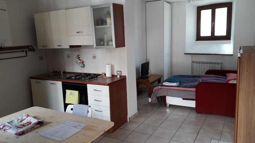 Kitchen with table and chairs. The fridge is present but it is not taken by the picture.