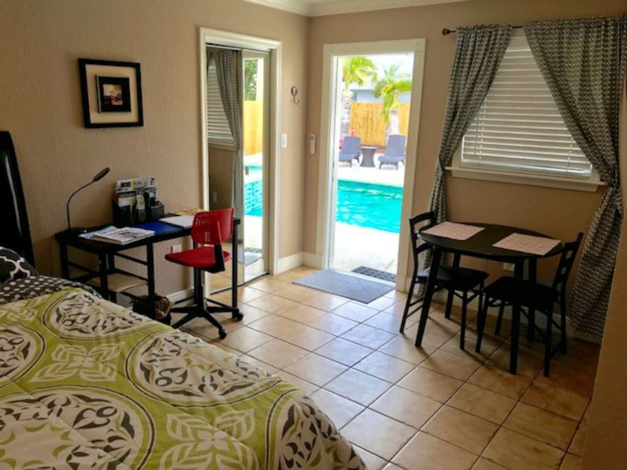 Your pool cottage with Temper-pedic bed, desk, and dining table