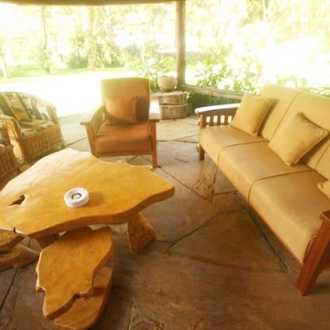 Rustic Ole itiko cottage 3 verandah garden view lounge