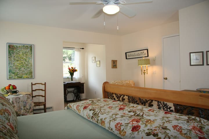 Bedroom 1: very spacious upstairs King bedroom with private, en-suite bathroom and charming country, antique accents.