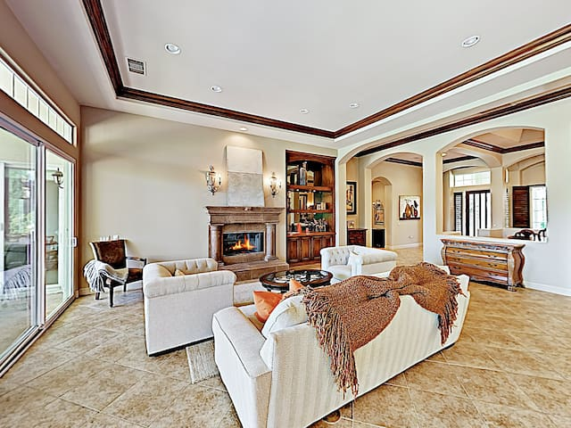 Cozy up by the gas fireplace in the sunlit living room.
