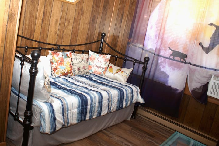 Twin room with day bed and trundle (the second twin bed is tucked away underneath).