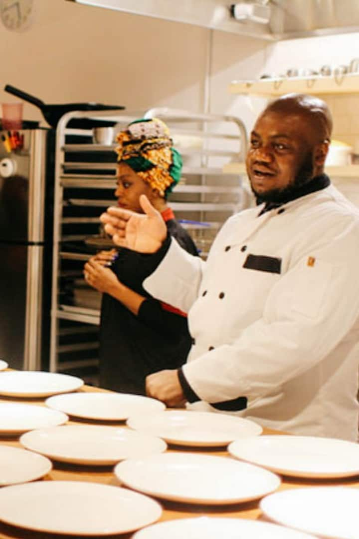 Chef Segun explaining the menu to the guests