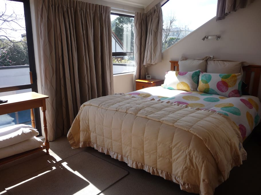 Sunny upstairs masterbedroom with ensuite